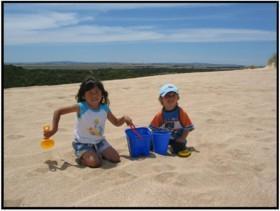 Children having fun on the sand at Canunda National Park